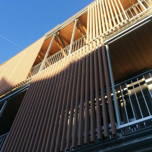 Pannelli scorrevoli lamelle legno composito